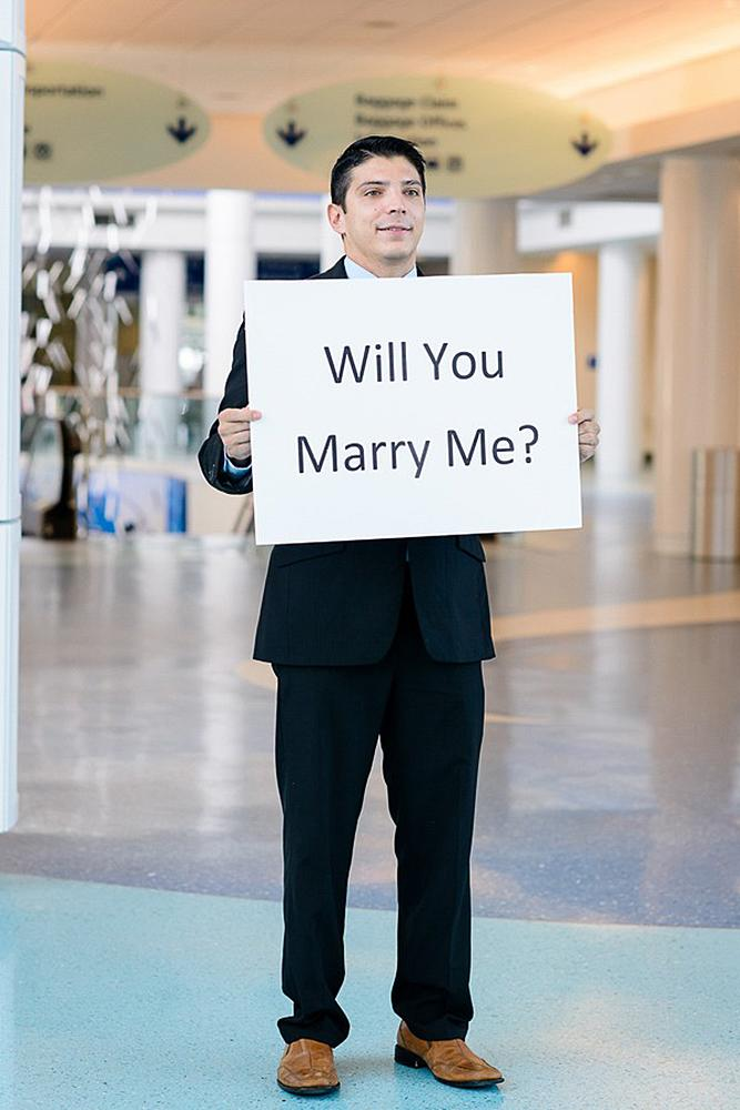 romantic ways to propose airport proposal surprise