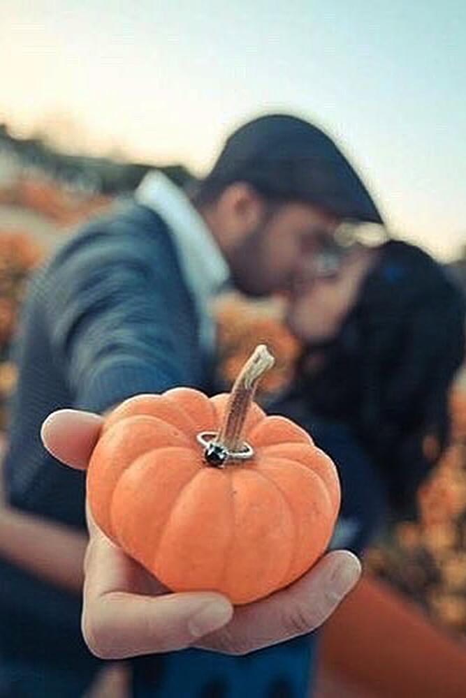 romantic ways to propose couple kiss engaged pumpkin
