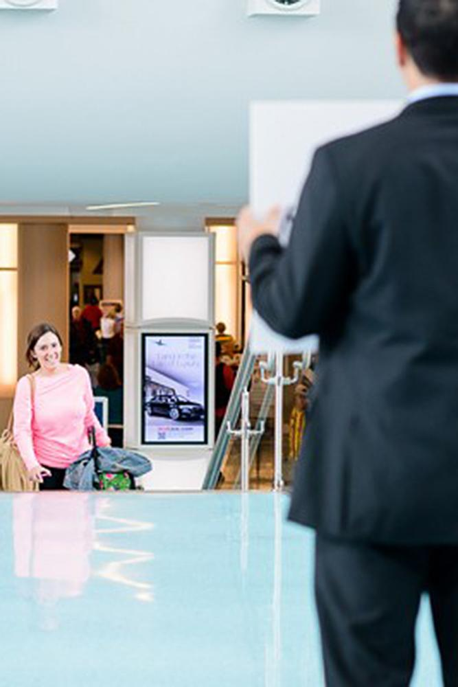 romantic ways to propose surprise airport proposal