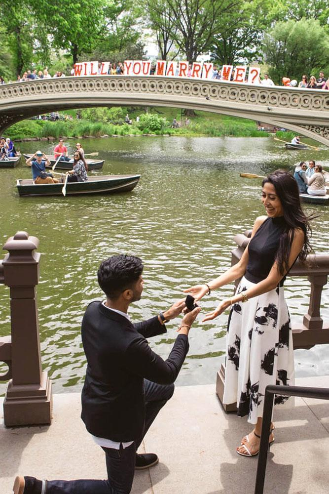 wedding proposal ideas in a park near bridge