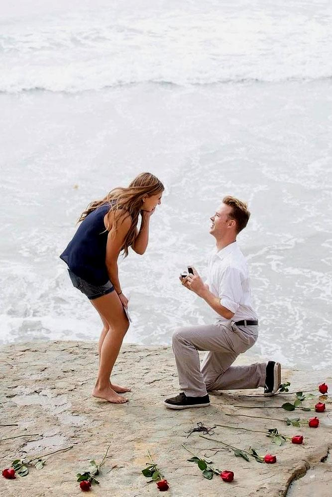 beach proposal ideas rose on the beach proposing