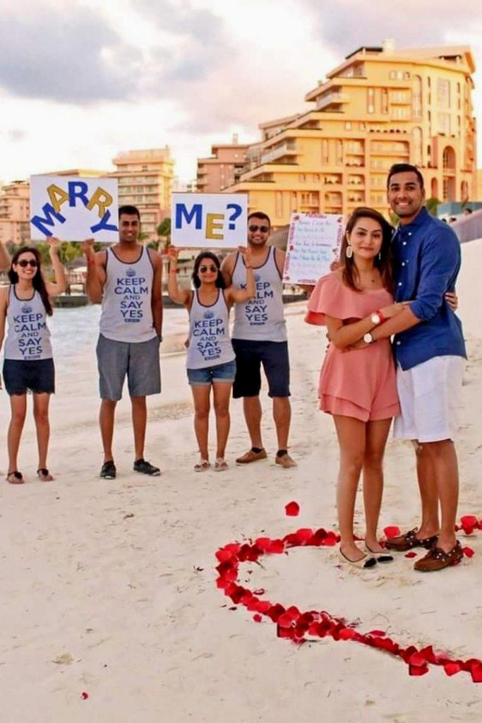 beach proposals engagement with friends help