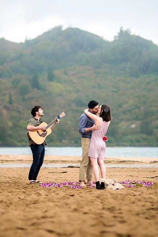 beach proposals romantic song for her near a sea