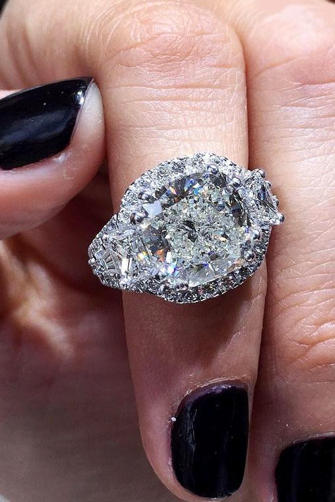 cushion cut engagement rings three stone halo white gold
