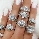diamond engagement rings on fingers in white gold