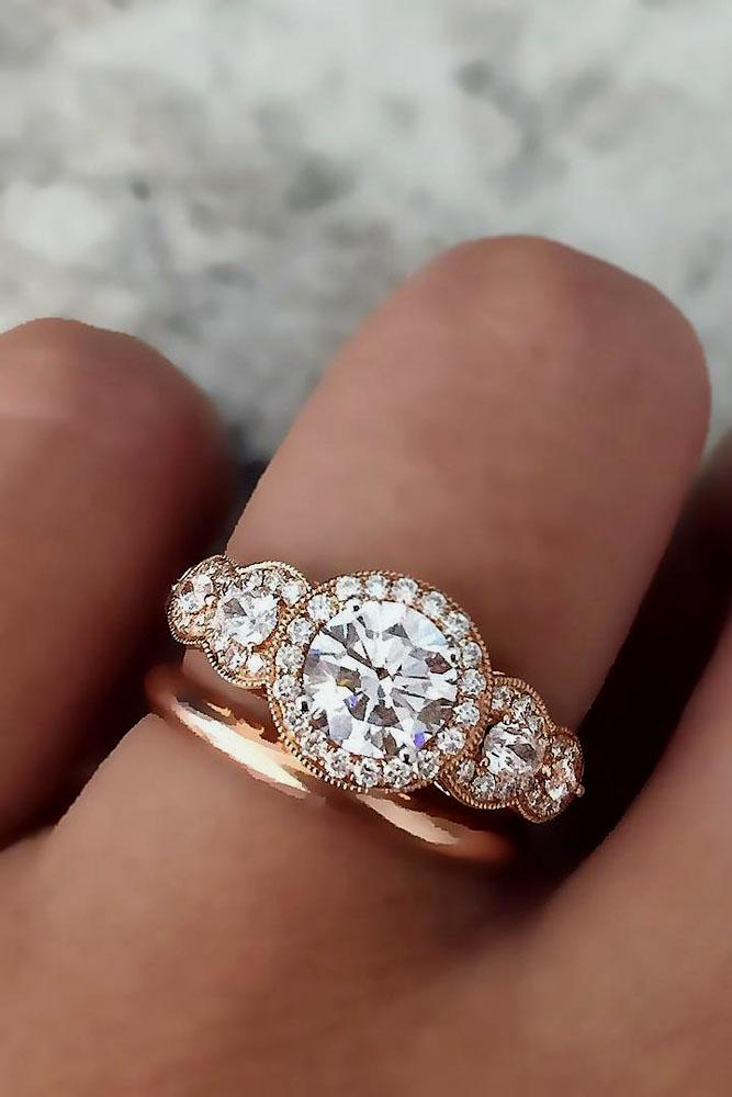 rose gold engagement rings three stones halo