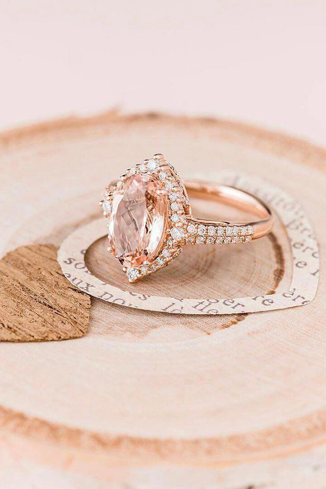 rose gold engagment rings marquise cut halo