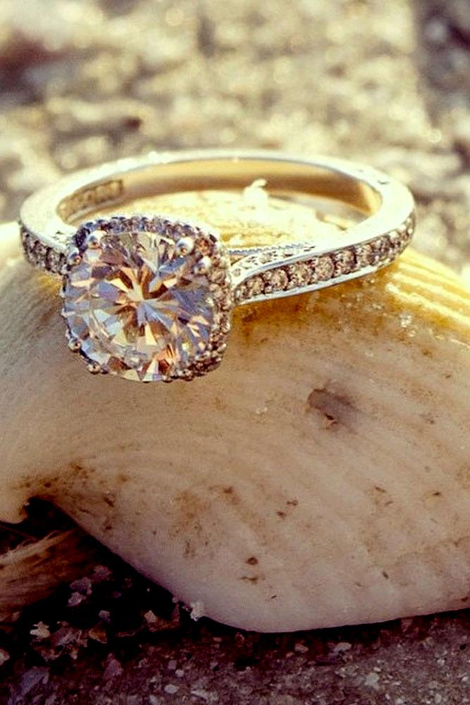 vintage engagement rings in white and rose gold with center round diamond