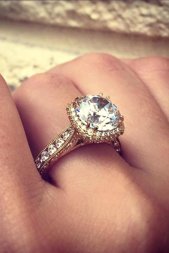 vintage engagement rings in yellow gold with halo and round diamond