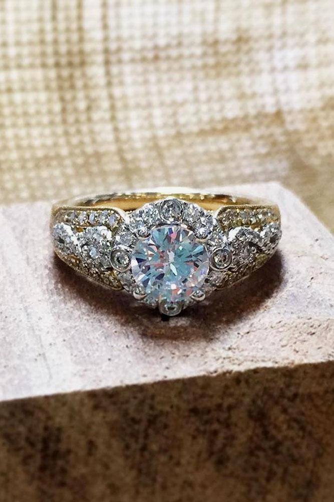 vintage engagement rings in yellow gold with halo round cut diamond