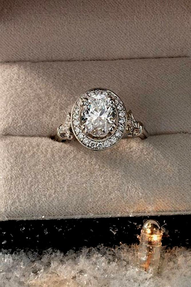 vintage engagement rings oval cut diamond in halo in white gold
