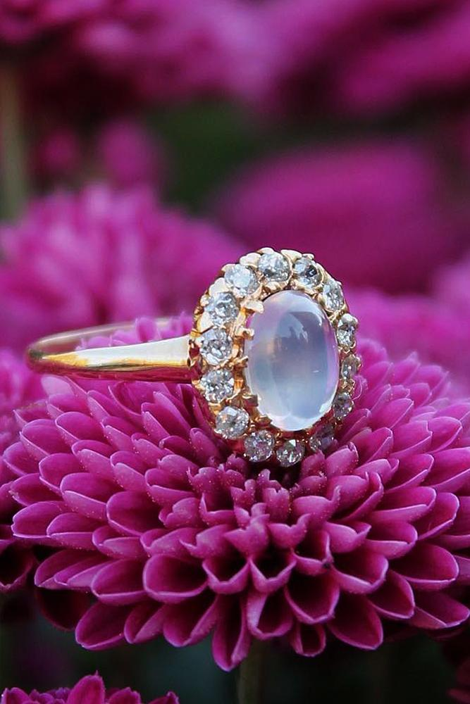 vintage engagement rings oval cut floral halo rose gold