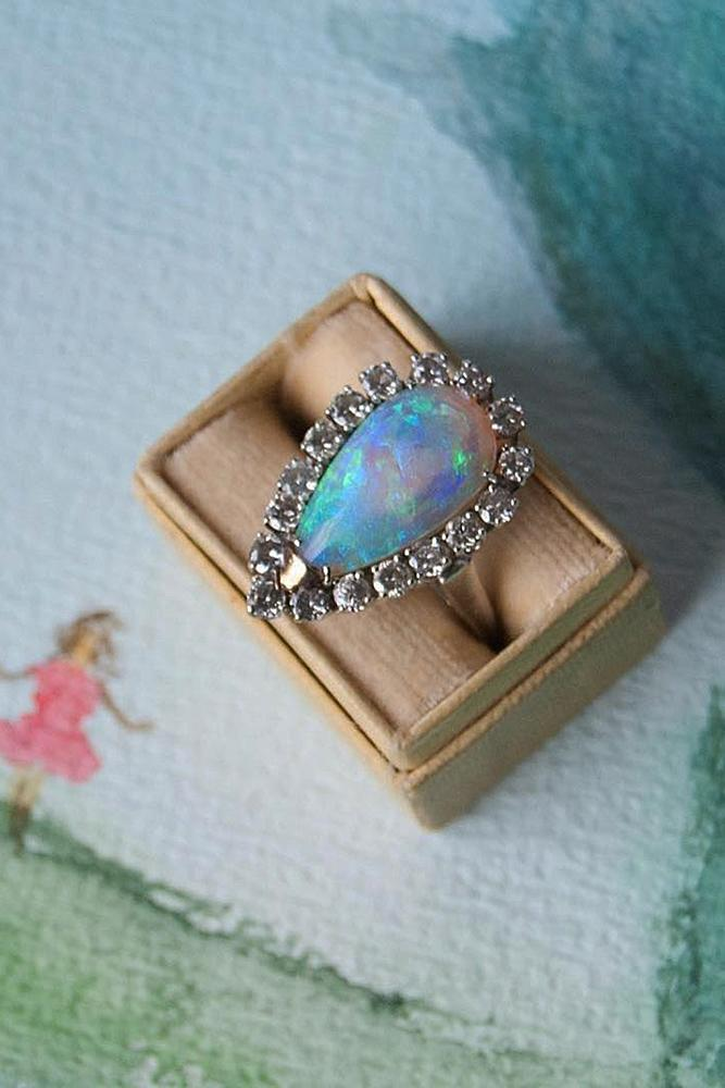 vintage engagement rings pear cut opal halo floral gold