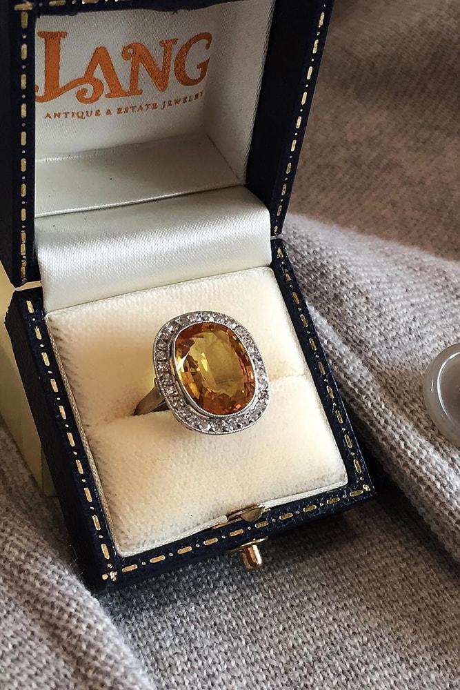 vintage engagement rings white gold oval cut gemstone halo vintage ring