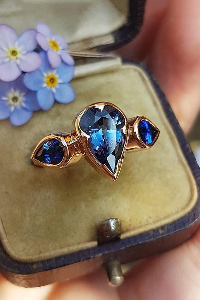 colored engagement rings rose gold pear cut blue sapphires three stones pave band simple