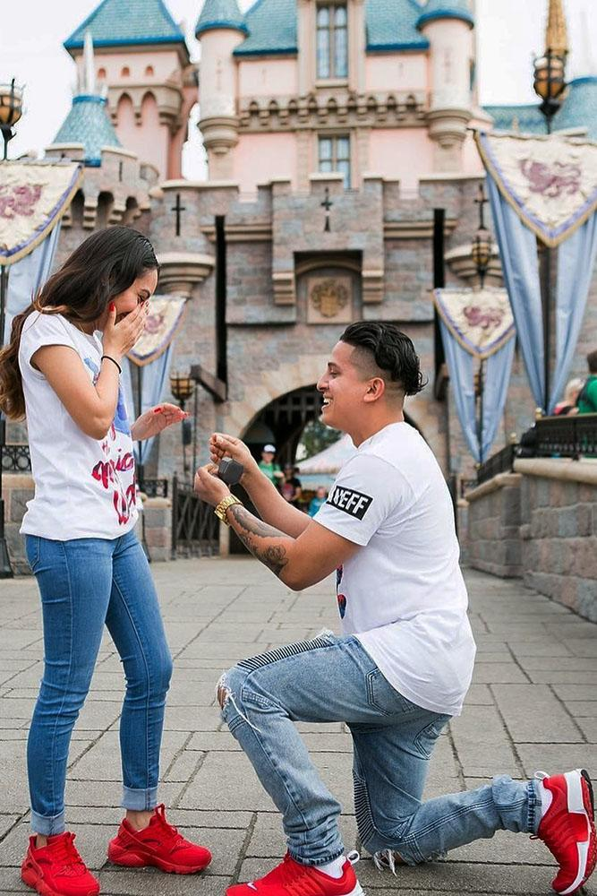 Disney proposals couple in red trainers