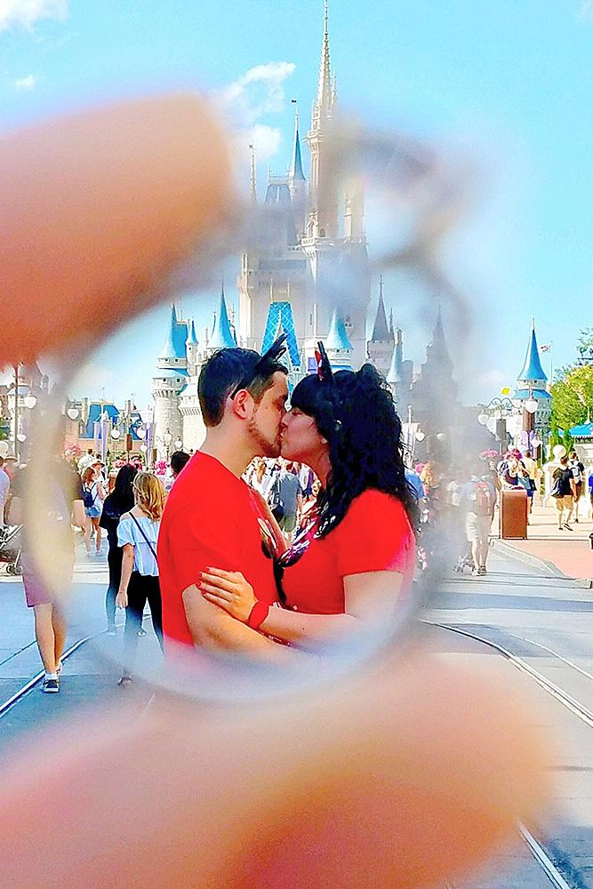 disney proposals couple kiss ring