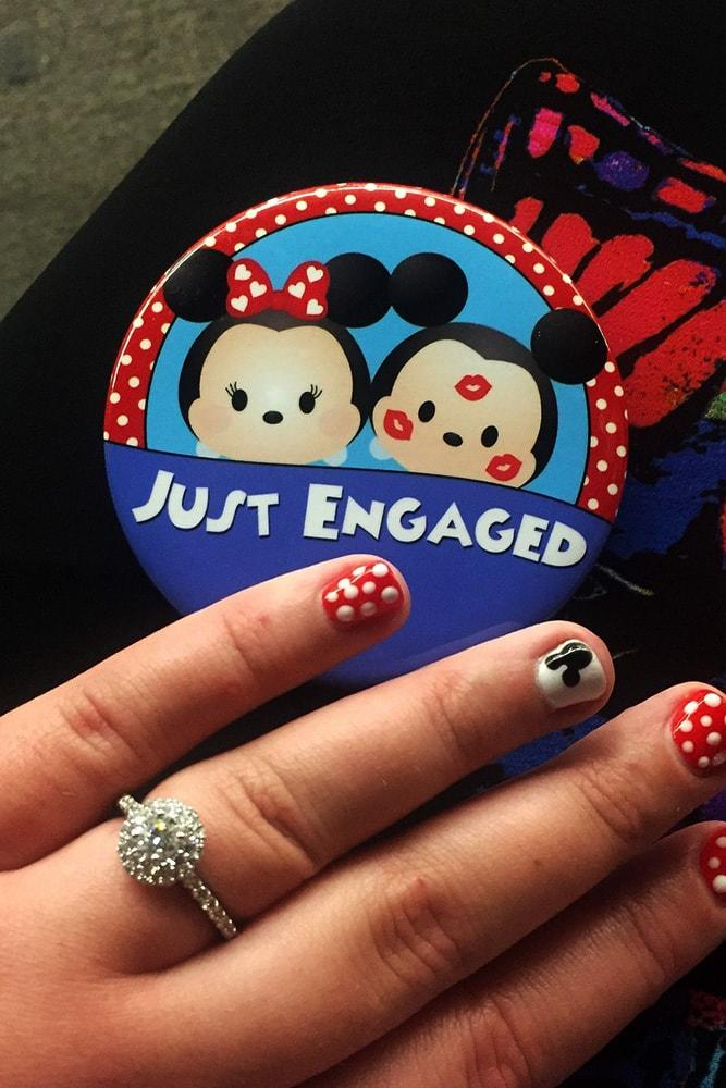 disney proposals ideas for inspiration hand with engagement ring and badge in disneyland style