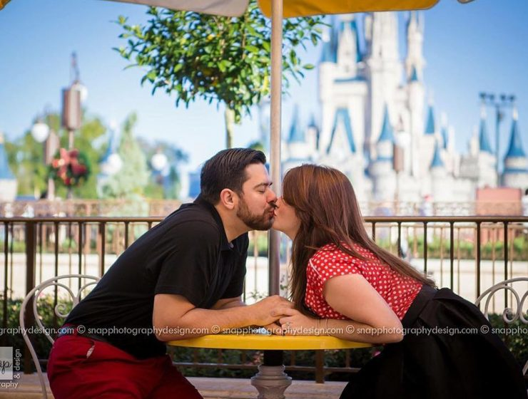 Disney proposals kiss on disney background