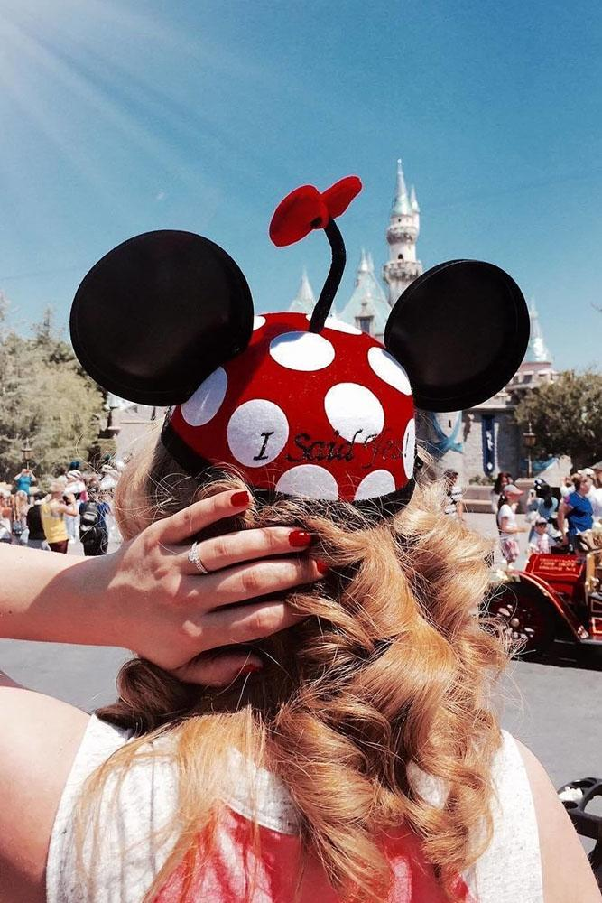 Disney proposals mini mouse hat on the girl with engagement rings