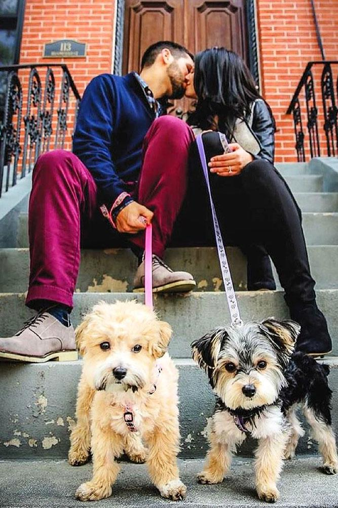 engagement photo ideas couple kiss dogs sit