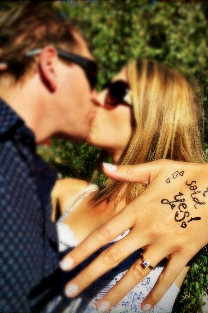 engagement photo ideas couple kiss on the hand she said yes