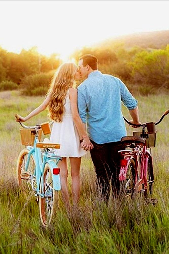 engagement photo ideas couple walk with bike