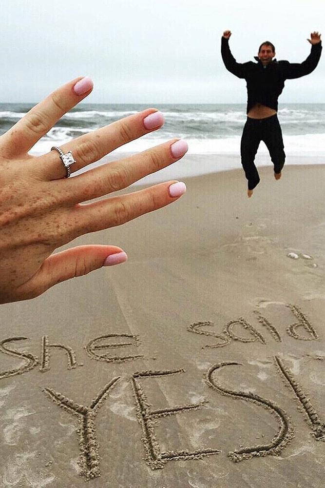 engagement photo ideas very happy man she said yes on a beach