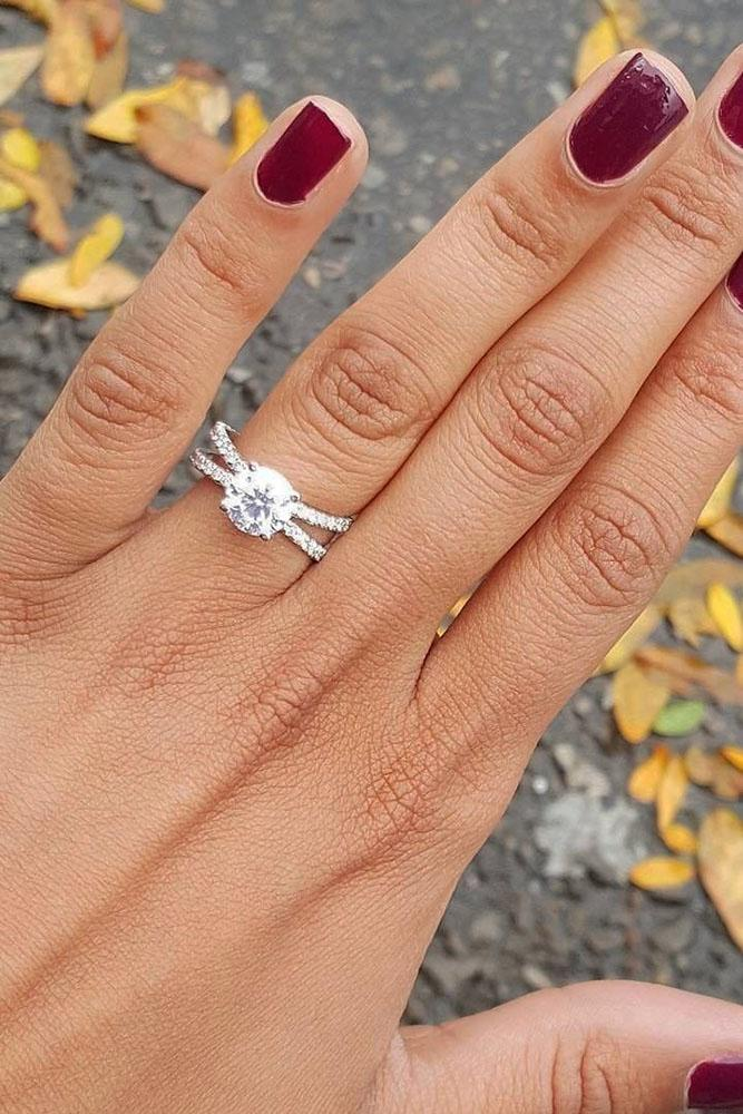 fall proposal ideas hand with engagement rings and yellow leaves