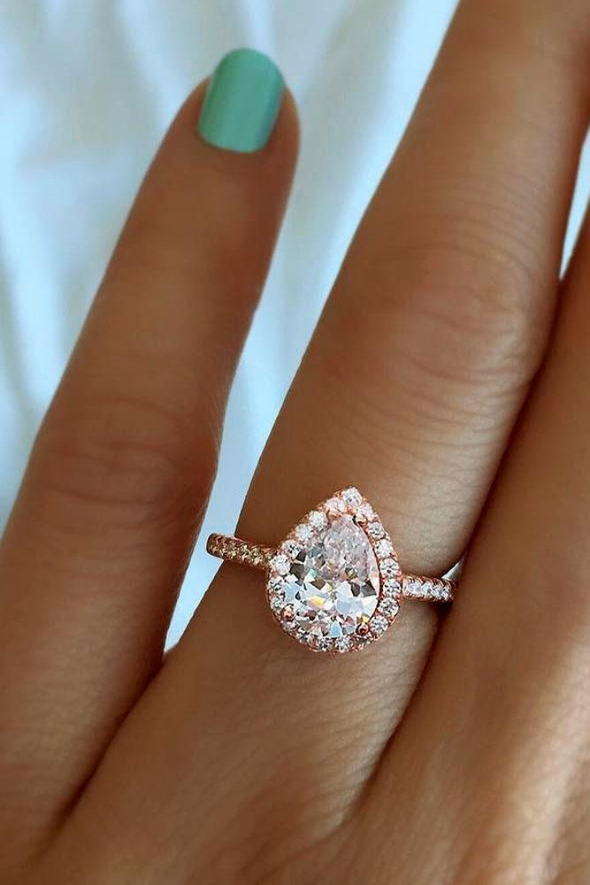 pear shaped engagement rings in rose gold with halo