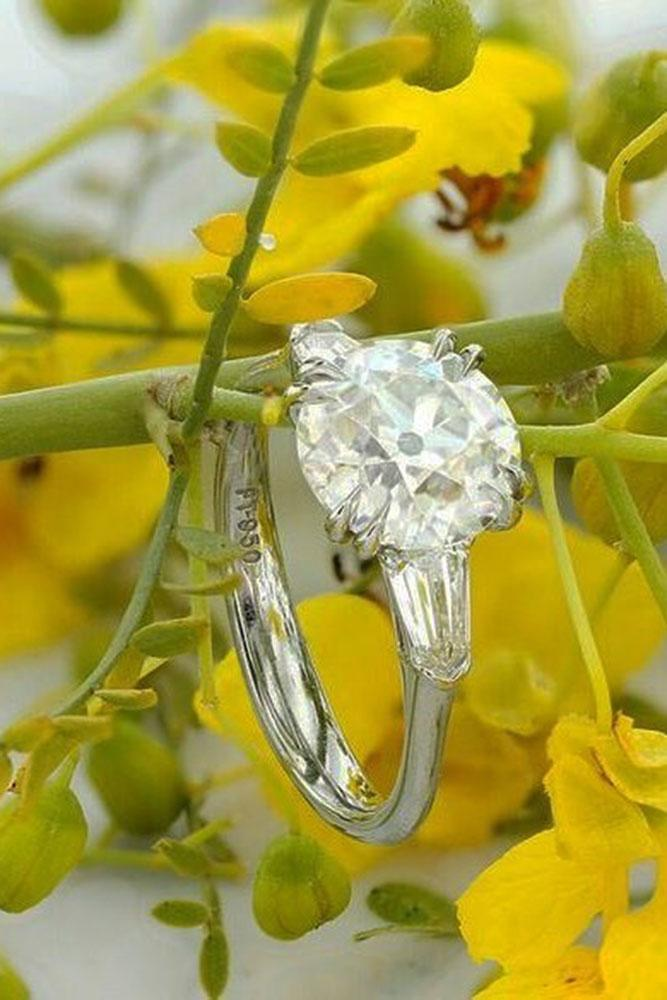 round engagement rings white gold three stones diamond