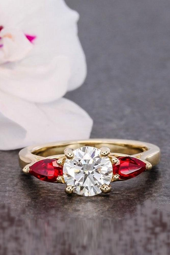 three stones engagement pear ruby center round cut diamonds rose gold