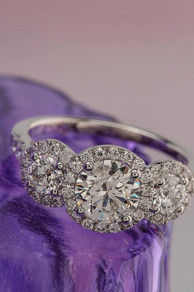 three stones engagement rings round cut diamonds in halo white gold
