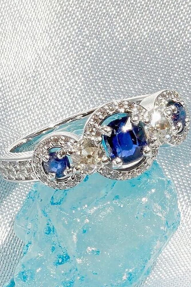 three stones engagement rings sapphire halo