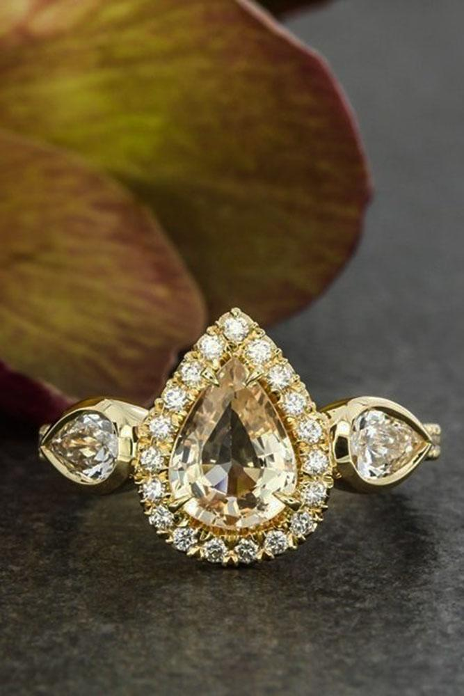 three stones engagement rings yellow gold diamond halo pear shaped