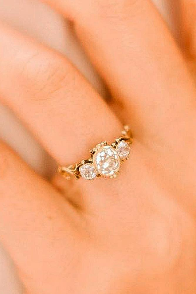 three stones engagement rings yellow gold diamond oval cut vintage