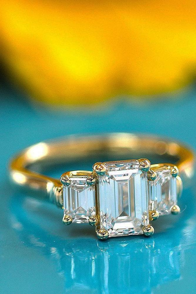 three stones engagement rings yellow gold emerald cut diamonds