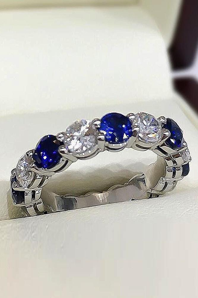 unique wedding rings white gold sparkle from diamonds and blue sapphires in pave band