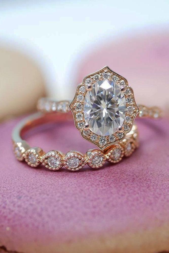 vintage wedding bands oval center diamond halo pave band