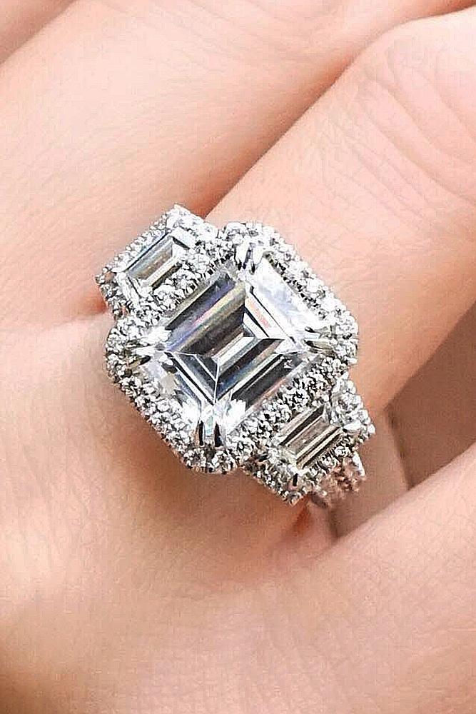 emerald engagement rings three stones halo white gold