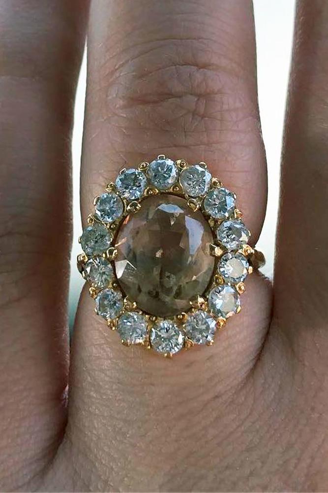 gemstone engagement rings oval cut halo topaz