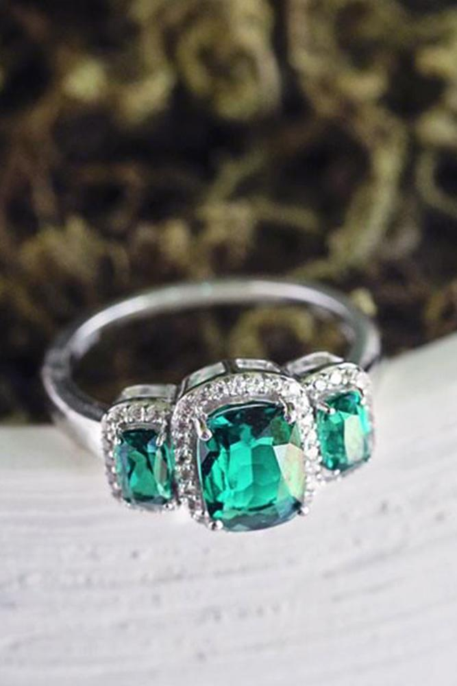 gemstone engagement rings three emerald stone brilliant halo platinum