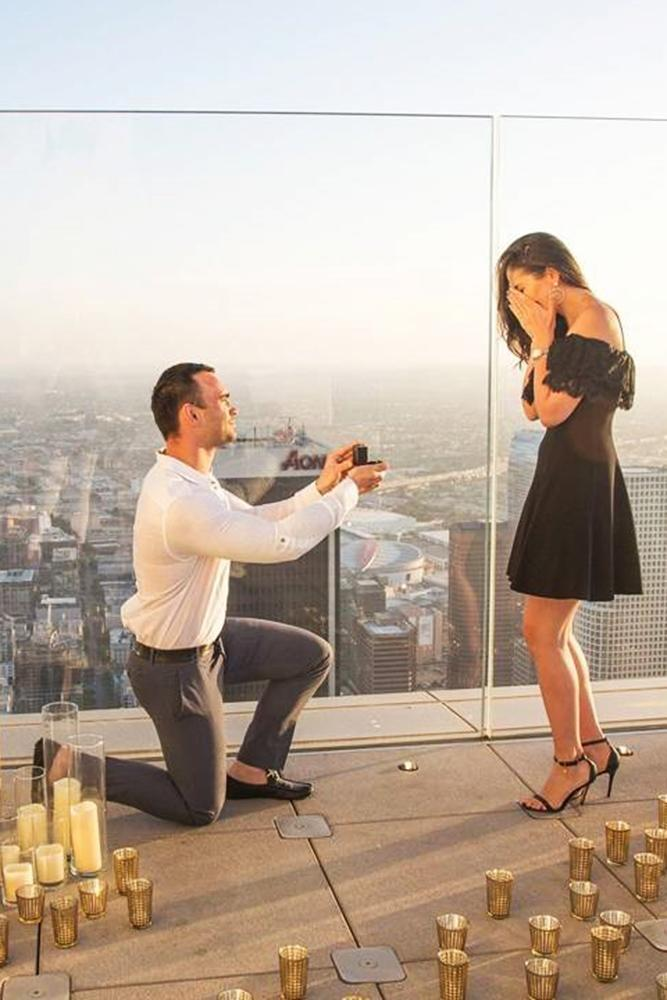 marriage proposal at the roof candle romantic