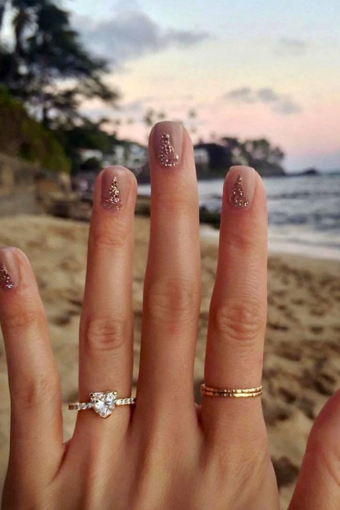 marriage proposal best engagement photo hand with ring sand background