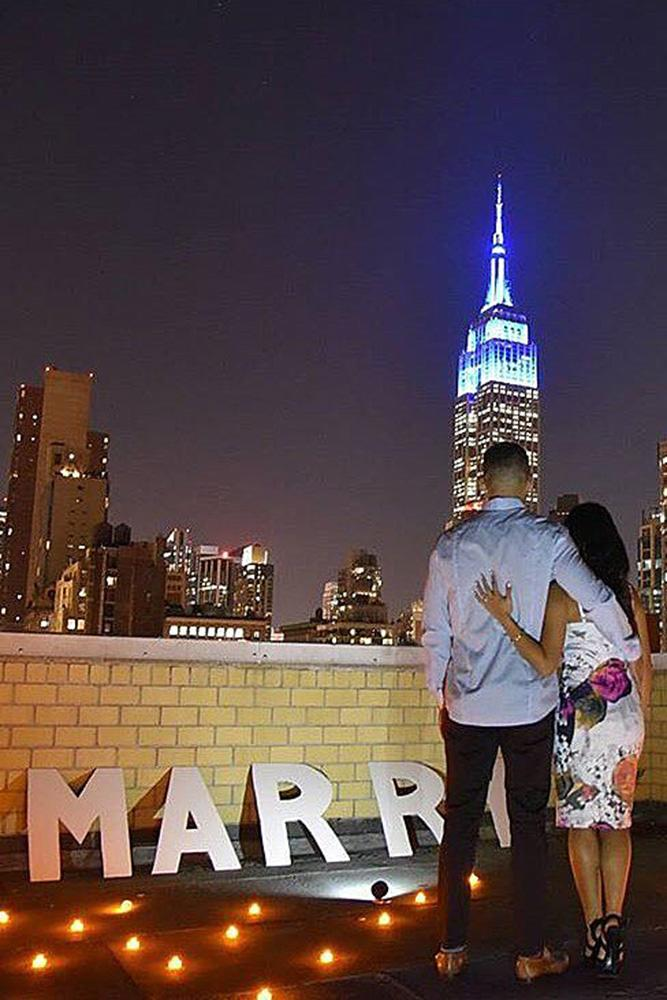 marriage proposal couple roof city engagement