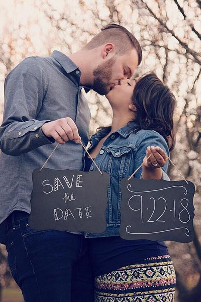 save the date ideas engaged couple kiss nature