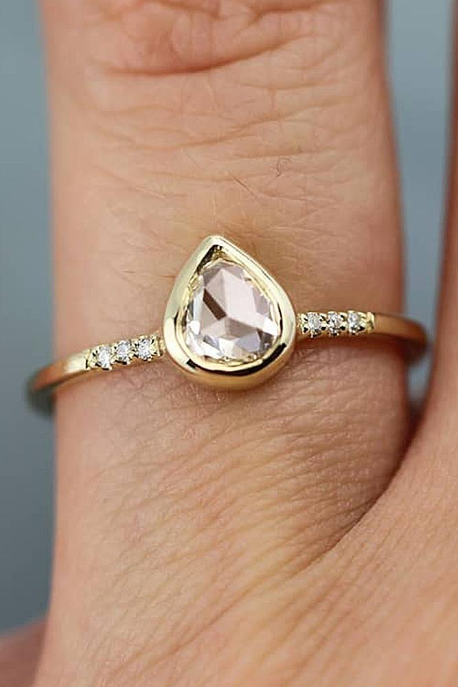 yellow gold engagement rings pear cut solitaire