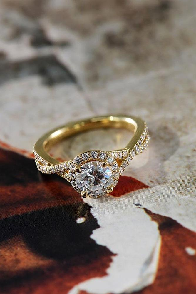 yellow gold engagement rings round cut diamond halo twist