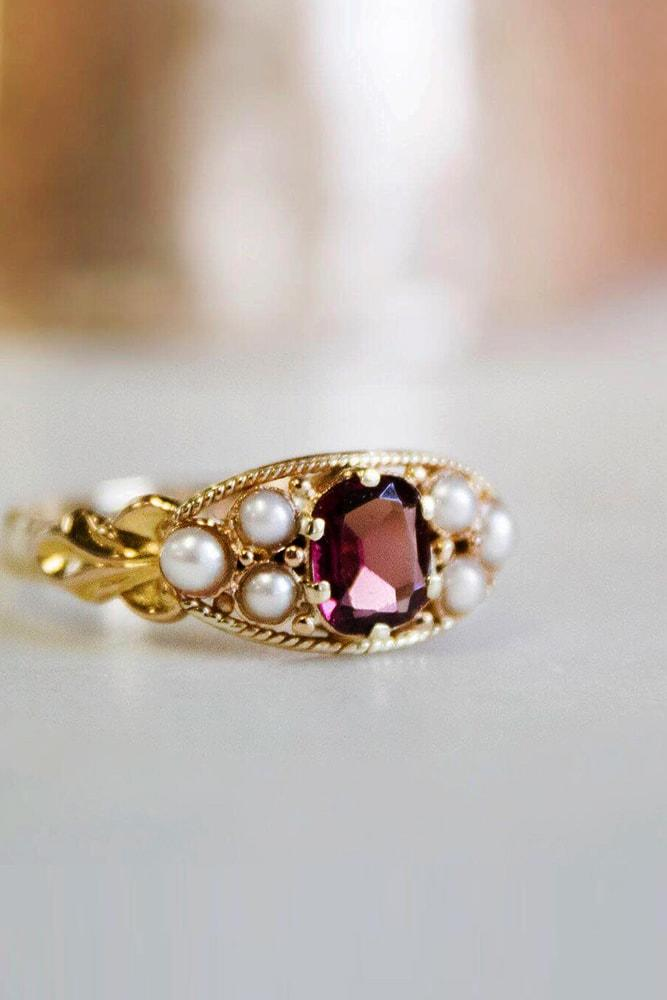 yellow gold engagement rings unique design cushion cut gemstone in the centre twisted pave band
