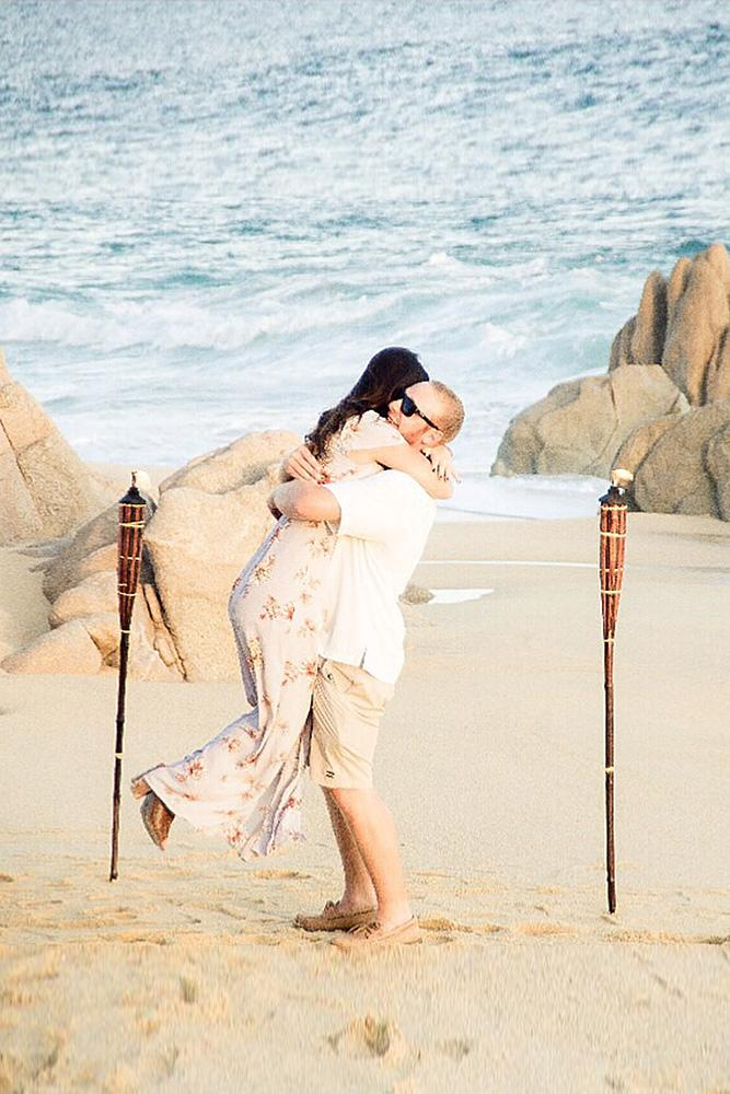 engagement photos beach couple sea